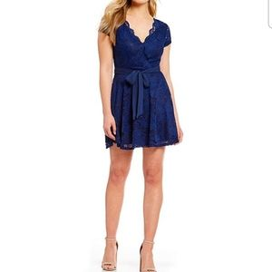 B darlin navy blue lace cap sleeve faux wrap dress